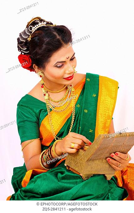 Indian woman dressed in sari and jewelry
