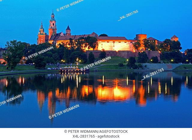 Panoramic view on Wawel Castle and the Vistula in Krakow by night, Poland, Europe