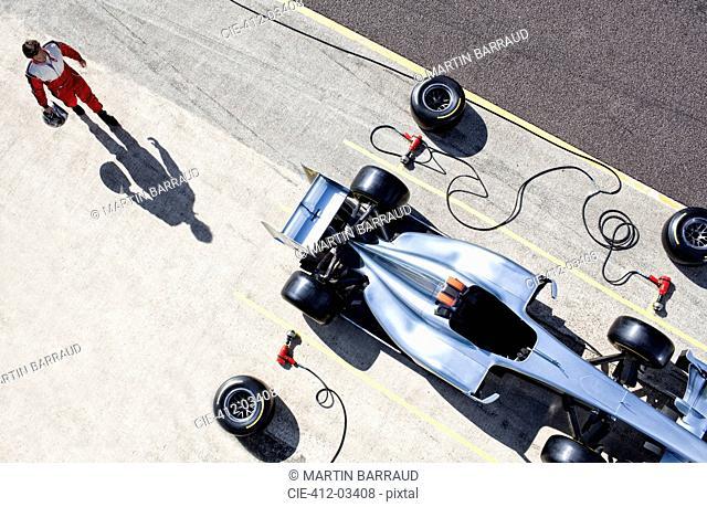 Racer walking to car in pit stop