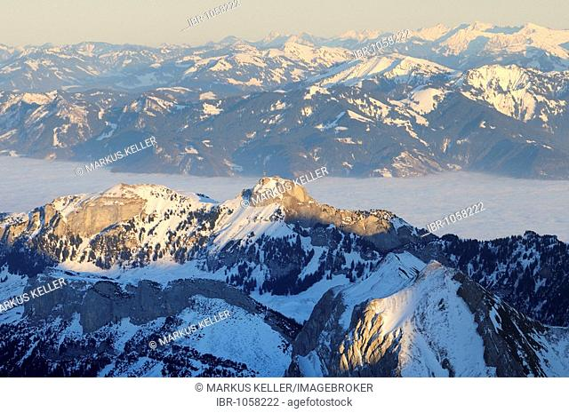 Mt Altmann and Mt Hoher Kasten in last daylight, between them the foggy Rheintal Valley, Canton of Appenzell Innerrhoden, Switzerland, Europe