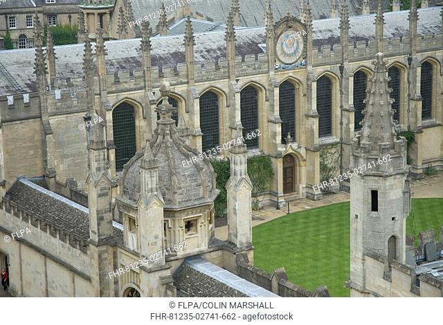 View of spires, sundial and colleges, St Mary's Church, Oxford University, Oxford, Oxfordshire, England, june