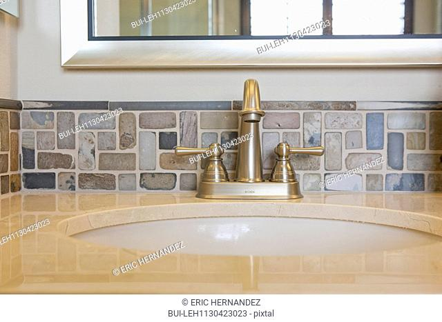 Faucet and spigots at bathroom sink