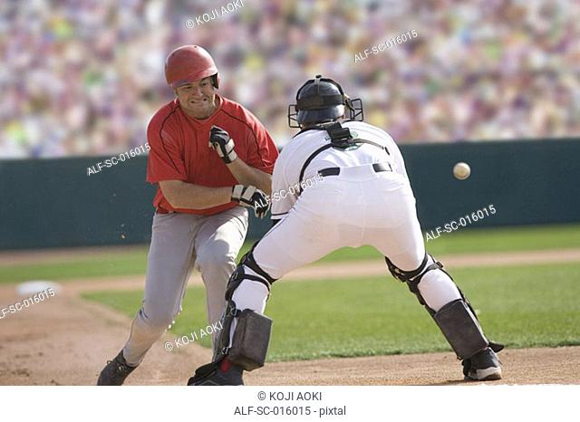 Baseball player charging the catcher