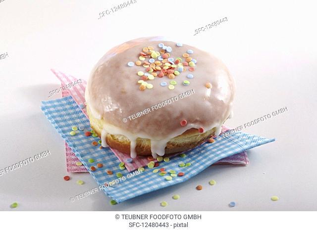 A carnival doughnut decorated with sugar confetti