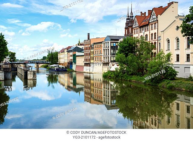 City reflection on Canal or river Odra, Opole, Poland