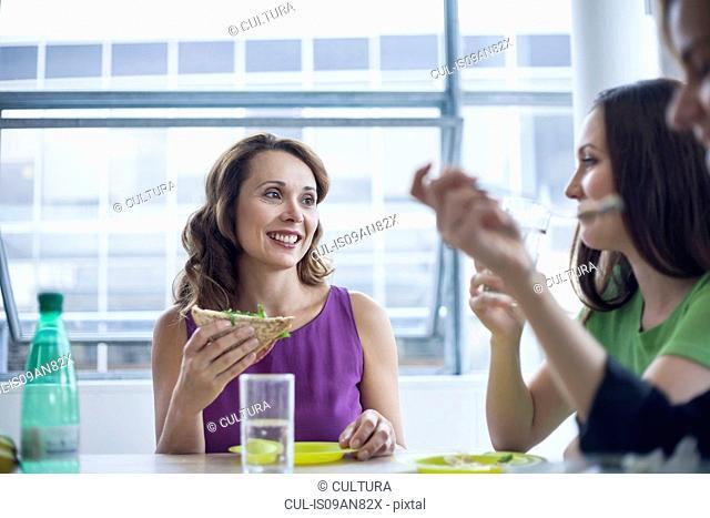 Three businesswomen enjoying lunch together