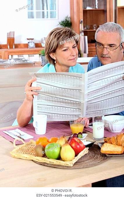 Middle-aged couple reading