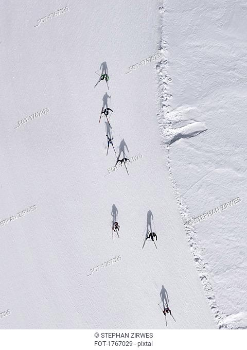 Aerial view of skiers on snowy slope, St. Moritz, Switzerland