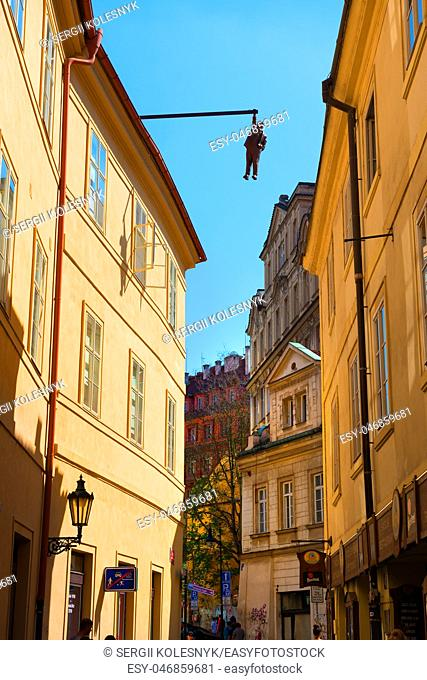 PRAGUE, CZECH REPUBLIC - July, 2018: Sculpture of the psychoanalyst Sigmund Freud hanging by a hand called Man Hanging Out created by the artist David Cerny
