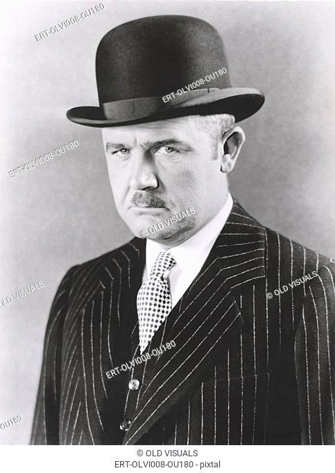 Dapper man in bowler hat (OLVI008-OU180-F)