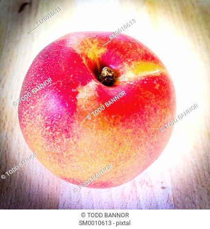 Nectarine on wooden cutting board