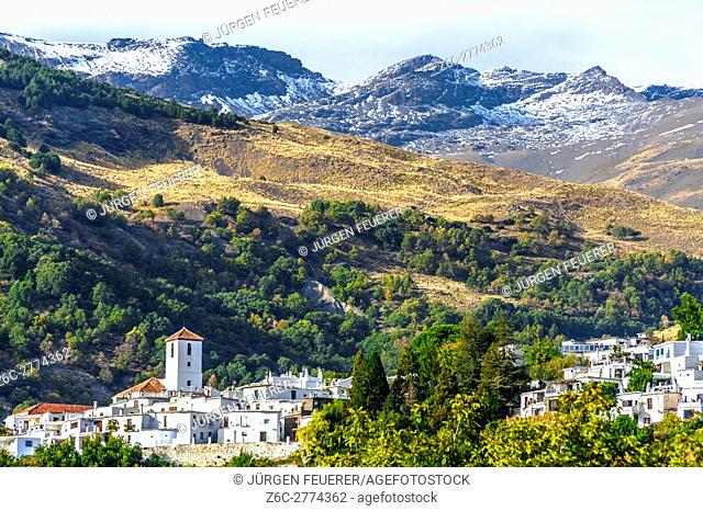white village Capileira in the Alpujarra and the peak of Mountain Mulhacén, Andalusia, Spain