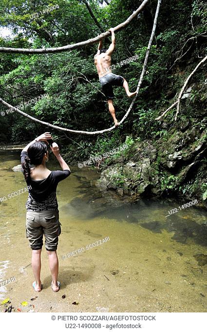 Okinawa (Japan): friends playing by the Ta waterfall
