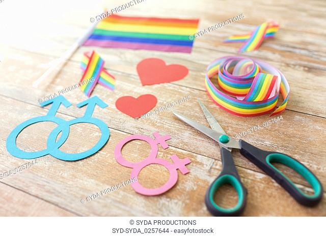 scissors and gay party props on wooden boards
