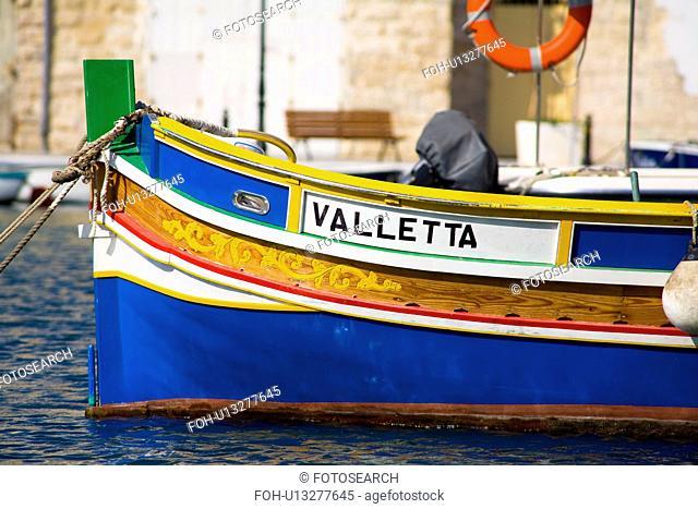 Luzzu fishing boat moored in Saint Julianãs Harbour, Spinola Bay, Saint Julianãs, Malta