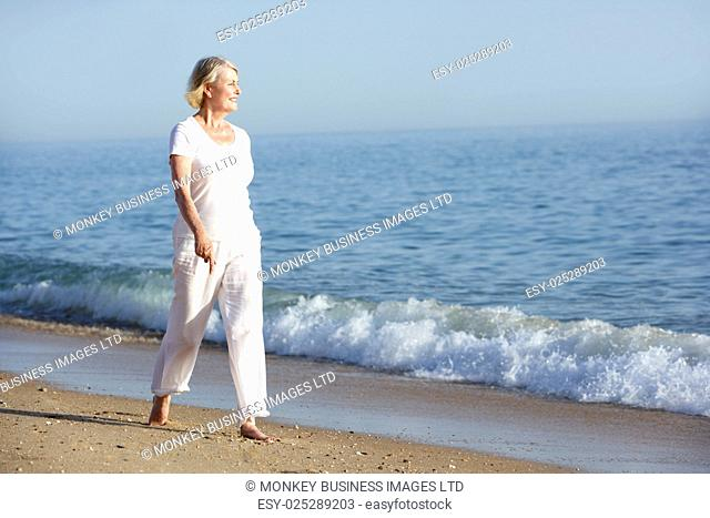 Senior Woman Enjoying Beach Holiday