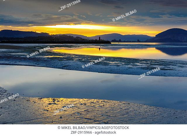 Tidal beach at sunset. Santoña, Victoria and Joyel Marshes Natural Park. Colindres, Cantabria, Spain