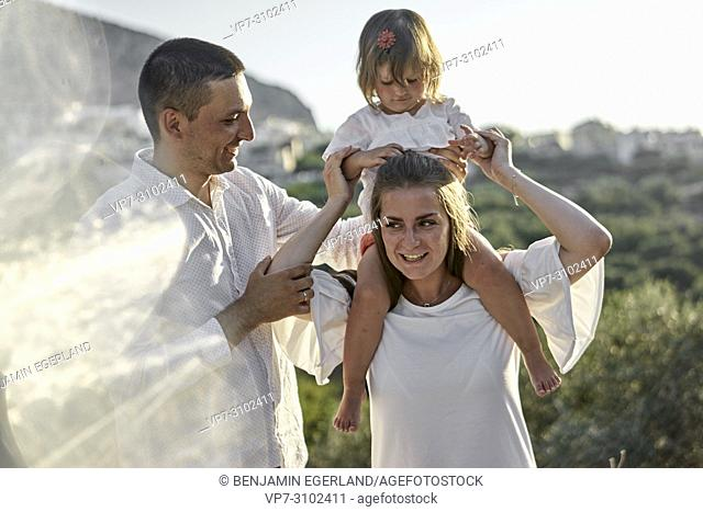 family outdoors in nature. In holiday destination Chersonissos, Crete, Greece
