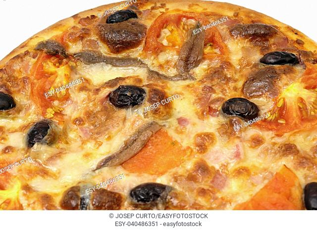 detail of a pizza with anchovy tomato olives