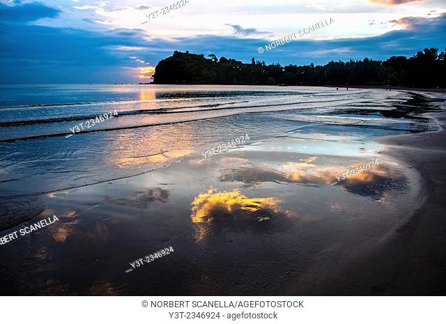 Asia. Thailand. Koh Lanta island. Klong Dao Beach. Clouds reflections in the water at sunset