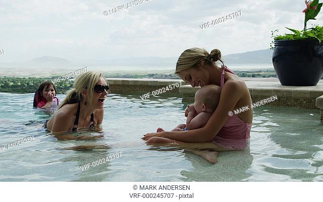 MS Kids (6-11 months, 4-5 years) and adults in pool / Cedar Hills, Utah, USA