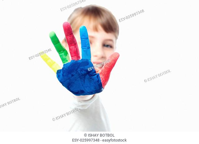 Little girl showing painted palm