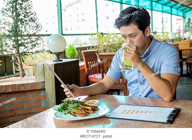 Young businessman at cafe