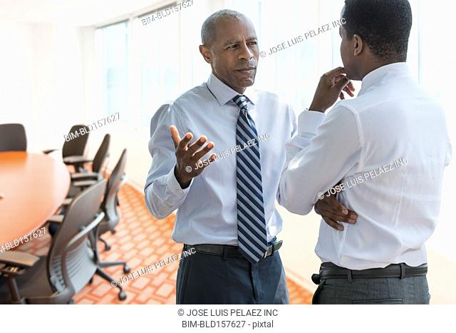 Black businessmen talking in office