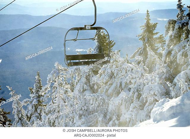 Empty ski lift chair in winter scenery, Vermont, USA