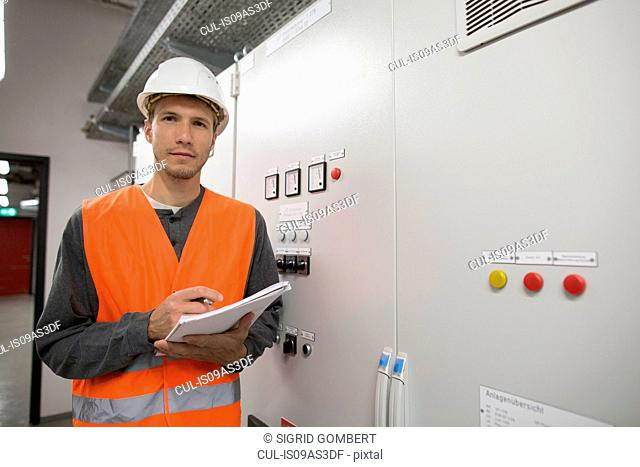 Portrait of young male engineer in technical room