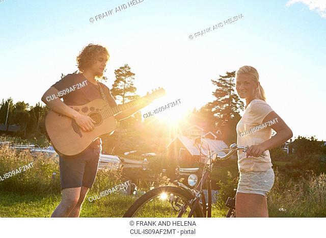 Young couple enjoying guitar, Gavle, Sweden