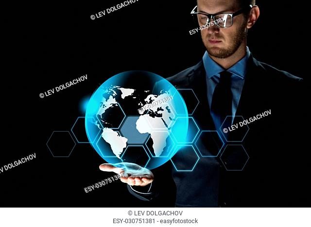 business, virtual reality, future technology and people concept - close up of businessman in suit with earth projection over dark background