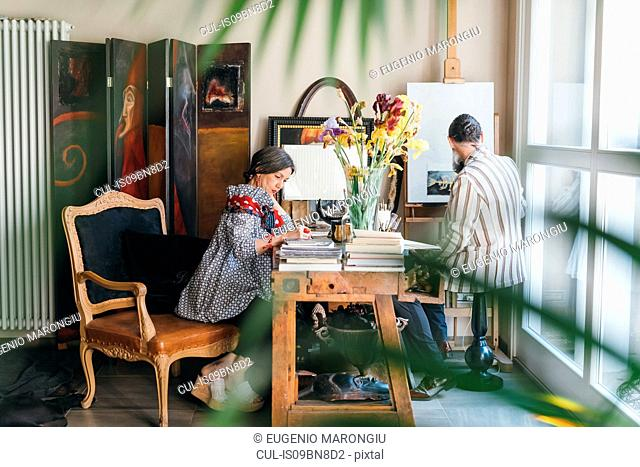 Couple working in their studio