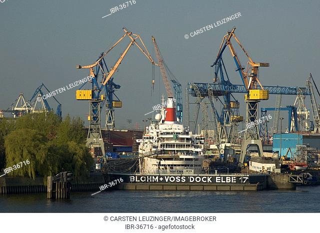 Cruising ship lying at a dock of Blohm and Voss at Hamburg Harbour Germany