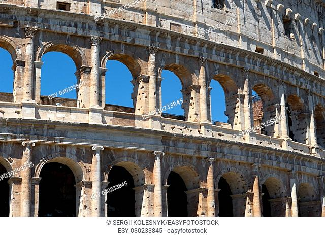 Arches of the majestic Colosseum in Rome, Italy