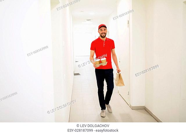delivery, mail and people concept - happy man delivering coffee and food in disposable paper bag to customer home