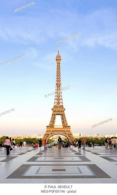 France, Paris, Eiffel Tower, tourists in foreground