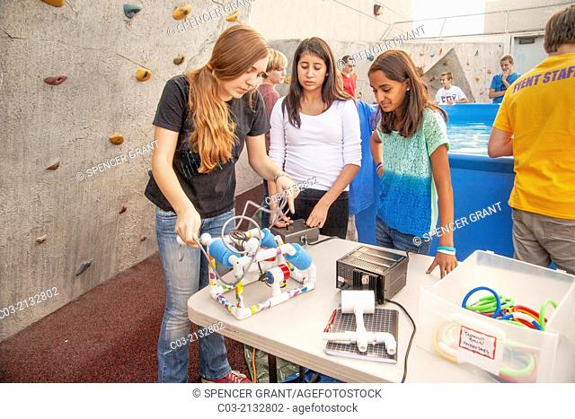 Multiracial middle school students in Mission Viejo, CA, prepare to test the remote operated submarine vehicles (ROV) they built in their robotics classroom in...