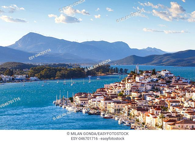 View of Poros island and mountains of Peloponnese peninsula in Greece.