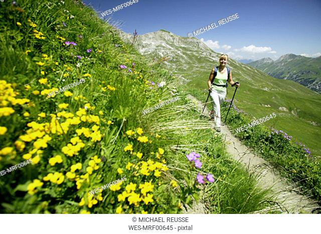 Woman hiking in austrian alps, elevated view