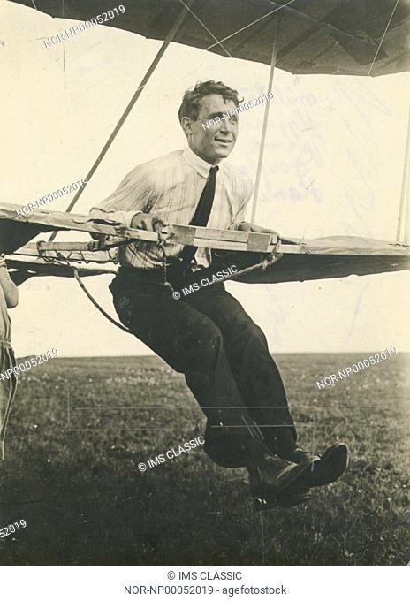 Douglas Hamilton riding a flying machine