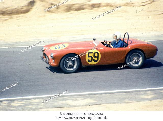 View of Mr. Pierre Mion behind the wheel of his 1957 AC Ace-Bristol Roadster No. 59 convertible sports car, driving at speed during the SCCA National Races in...