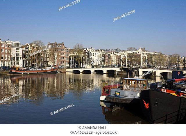 The Amstel River and Magere Bridge, Amsterdam, Netherlands, Europe