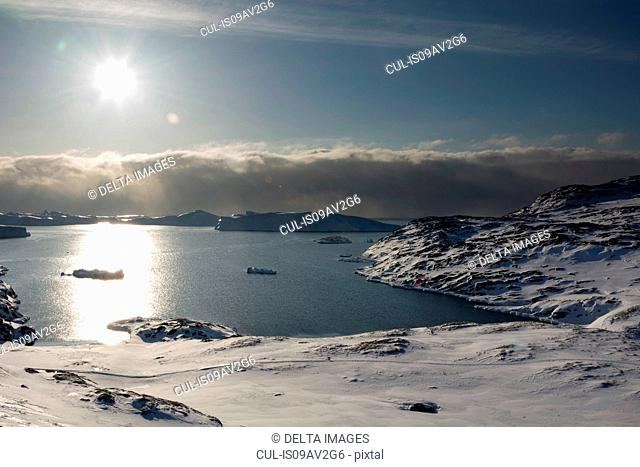 Elevated sunlit view of Ilulissat icefjord, Disko Bay, Greenland