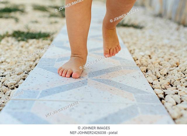 Childs feet on path