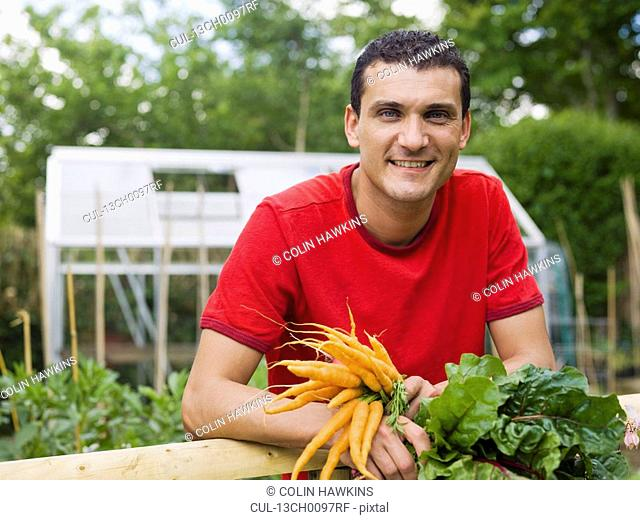 Man in garden with vegetable crops