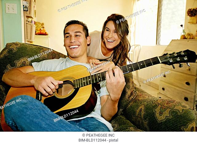 Smiling couple relaxing in living room