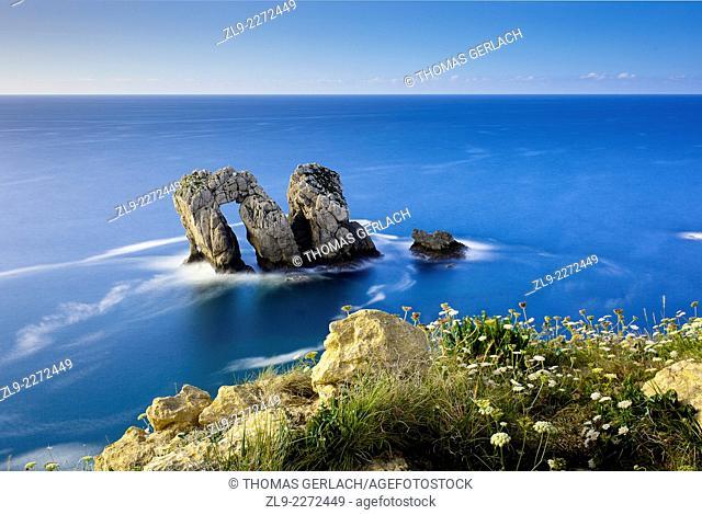 Dramatic arch in rocks Cantabria coast