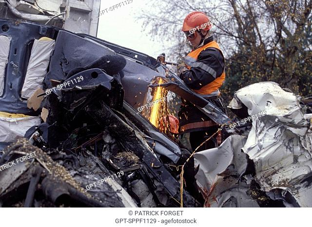 FIREMEN AT A ROAD ACCIDENT, FREEING THE VICTIM FROM A HEAVY GOODS VEHICLE, BRIONNE, EURE 27, FRANCE