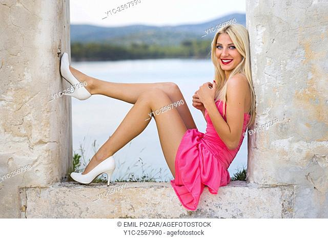 Beautiful young lady fanciful in tight space